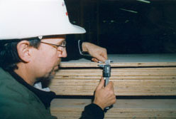 Measuring plywood thickness.