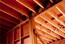 Underside of floor showing joists. The fire-resistance rating is required from the underside of the assembly only.